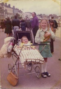 Me (the fat one in the pram!) and my amazing sister, Sally, contemplating a hoopy future!